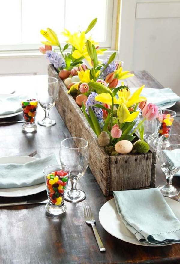 Rustic box with flowers and eggs